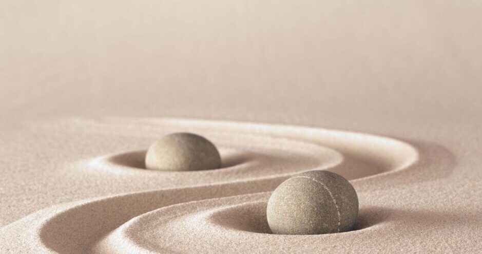 Two stone balls in sand. showing balance and harmony