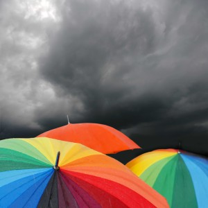 colourful umbrellas give protection from the overhead storm