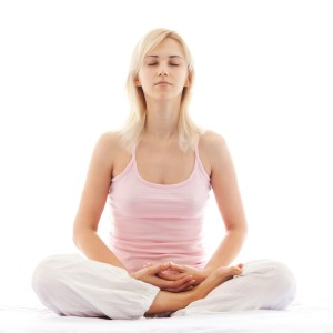 woman dealing with stress by meditating