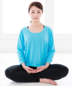 chinese lady in traditional meditation posture