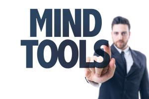 man pointing to words mind tools