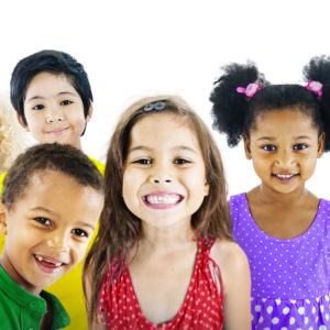 group of kids smiling and being positive