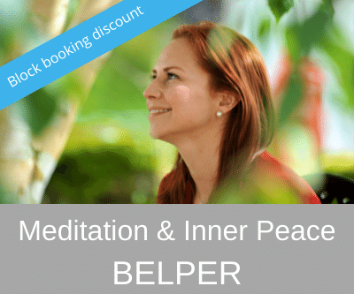 woman sitting in traditional meditation posture with serene smile